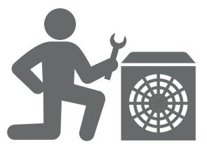 Image of an HVAC mechanic standing next to an AC unit