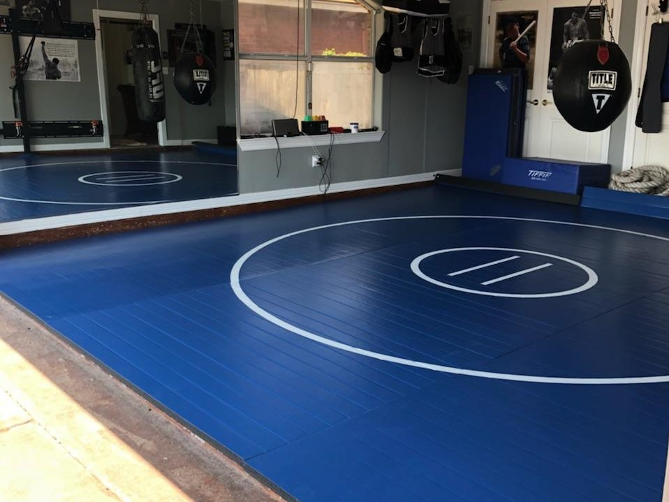 Home wrestling room with floor mats
