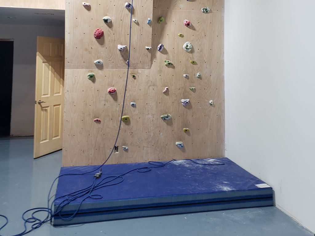 Rock climbing wall crash mat blur
