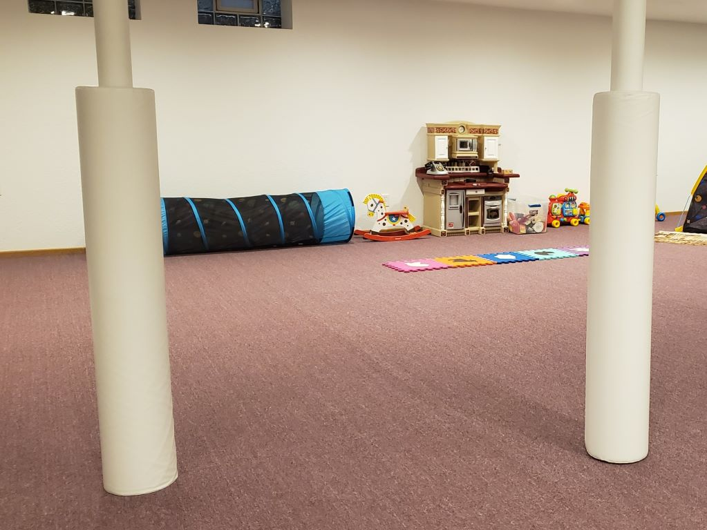 Home basement playroom white pole pads