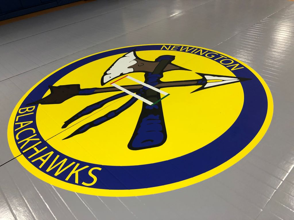 High school logo on competition mat