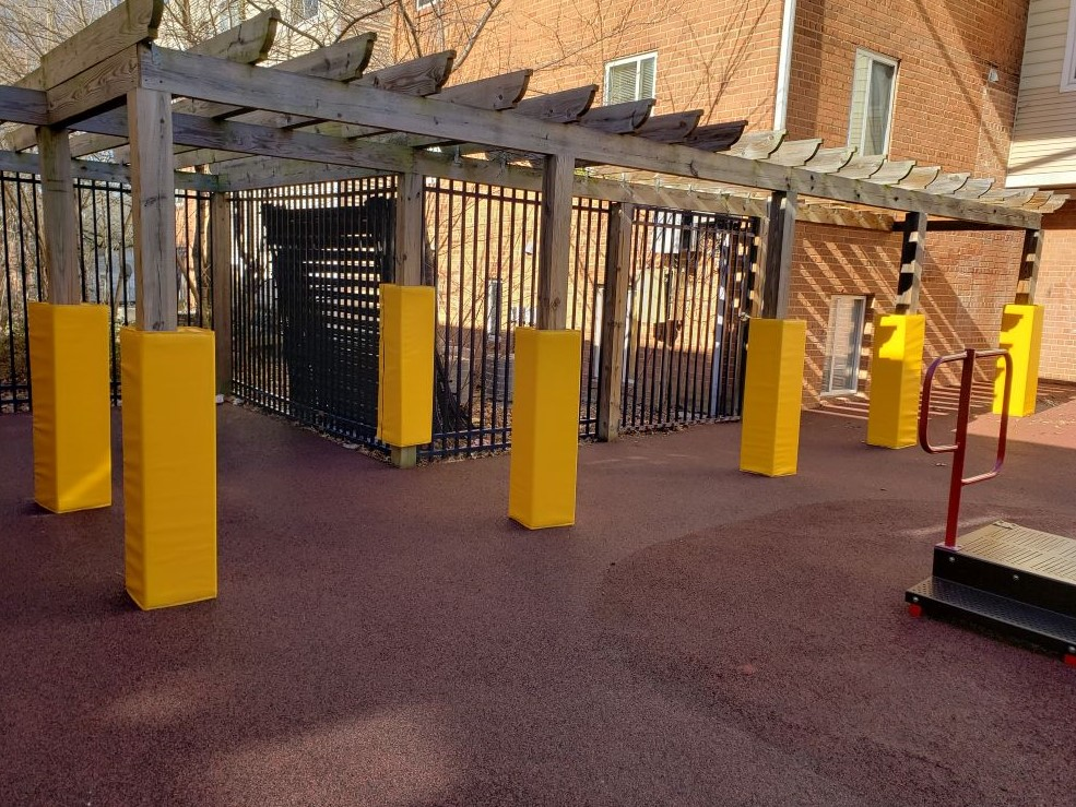 multiple yellow playground pole pads