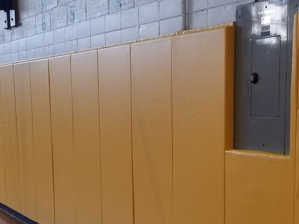 Yellow gymnasium wall safety pads