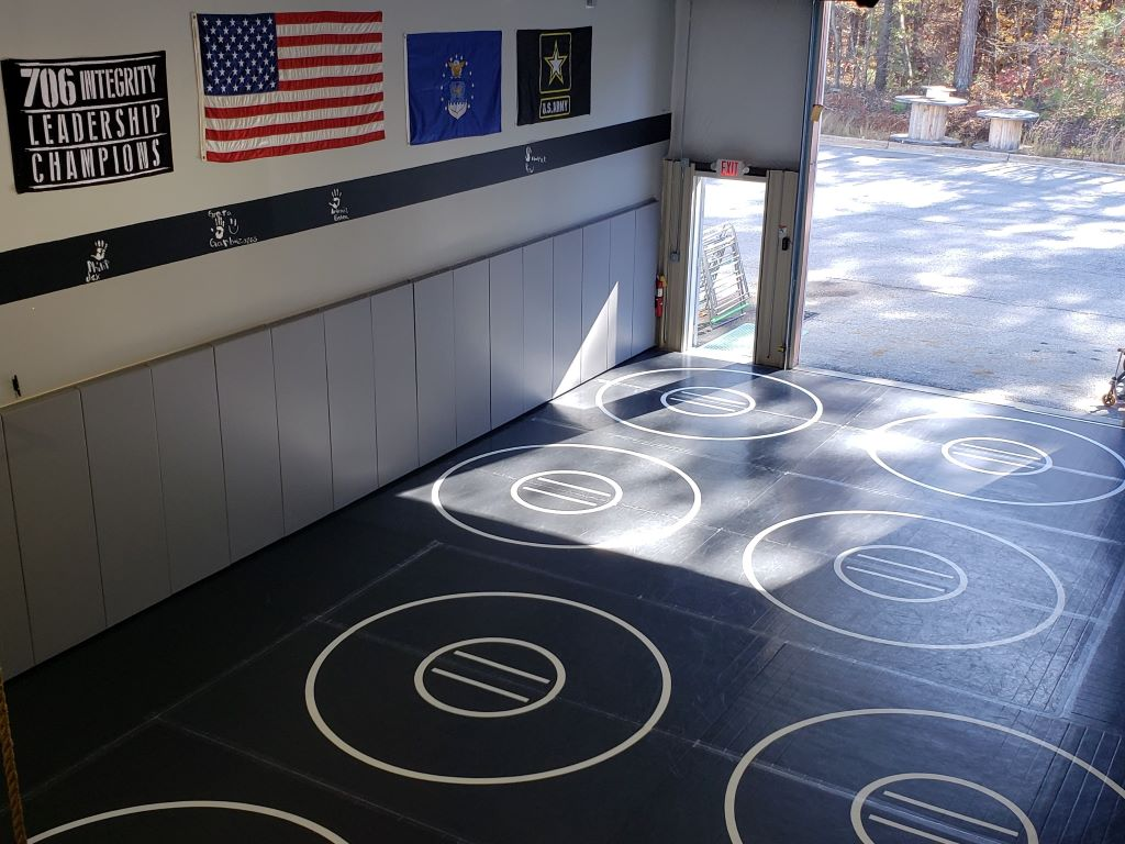 grey wall pads in school practice wrestling room