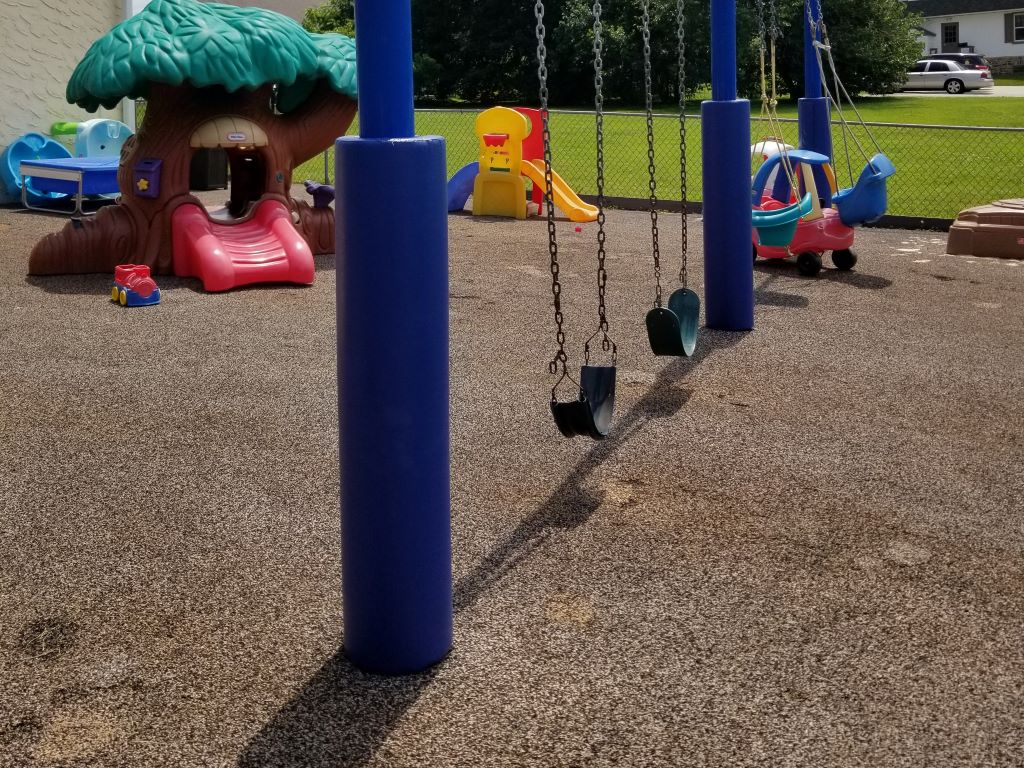 Outdoor playground pole pads for swing set