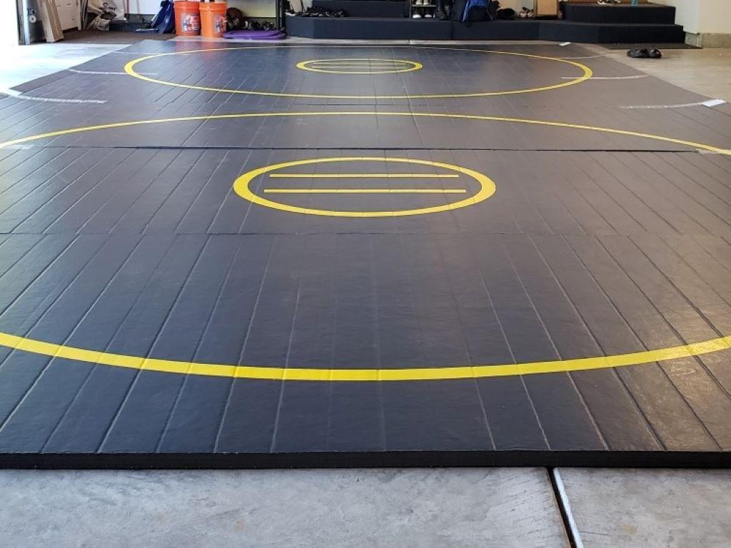 black wrestling mat in home garage for after school training