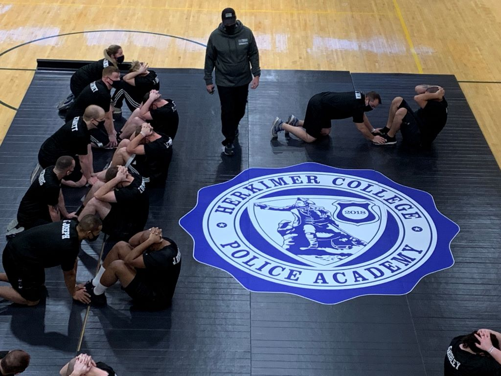 black wrestling mat with custom police academy logo