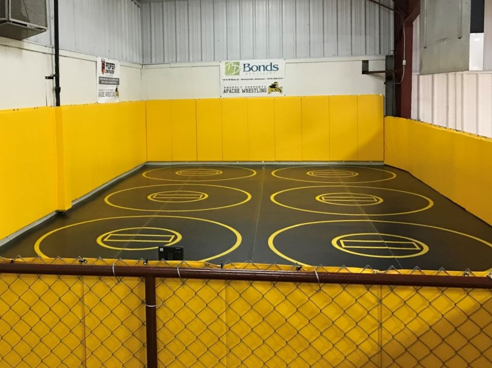 Black grappling mats, black practice circle wrestling mats, black and yellow wrestling mat