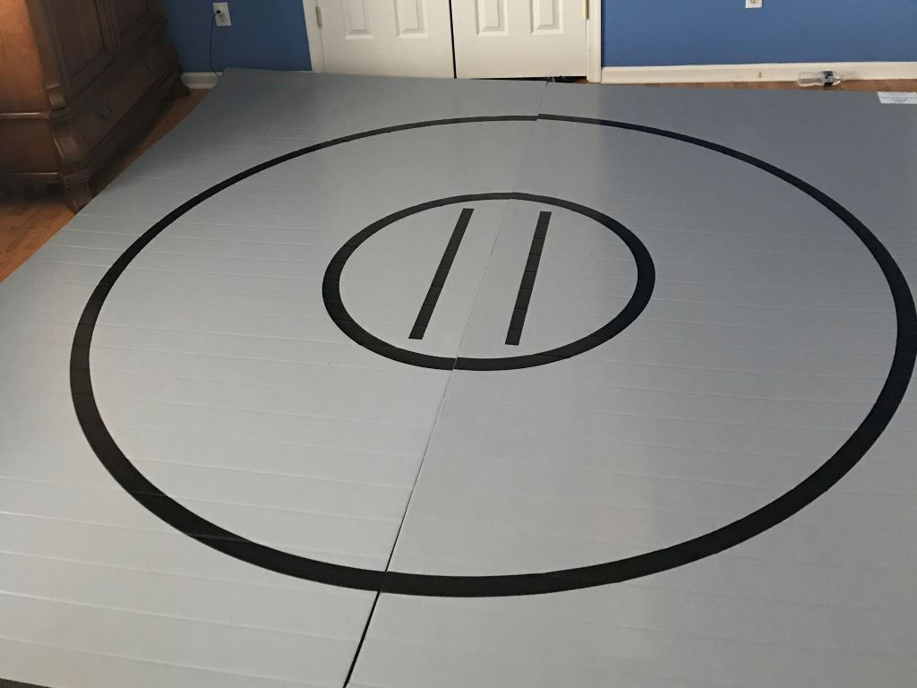 grey home wrestling mat