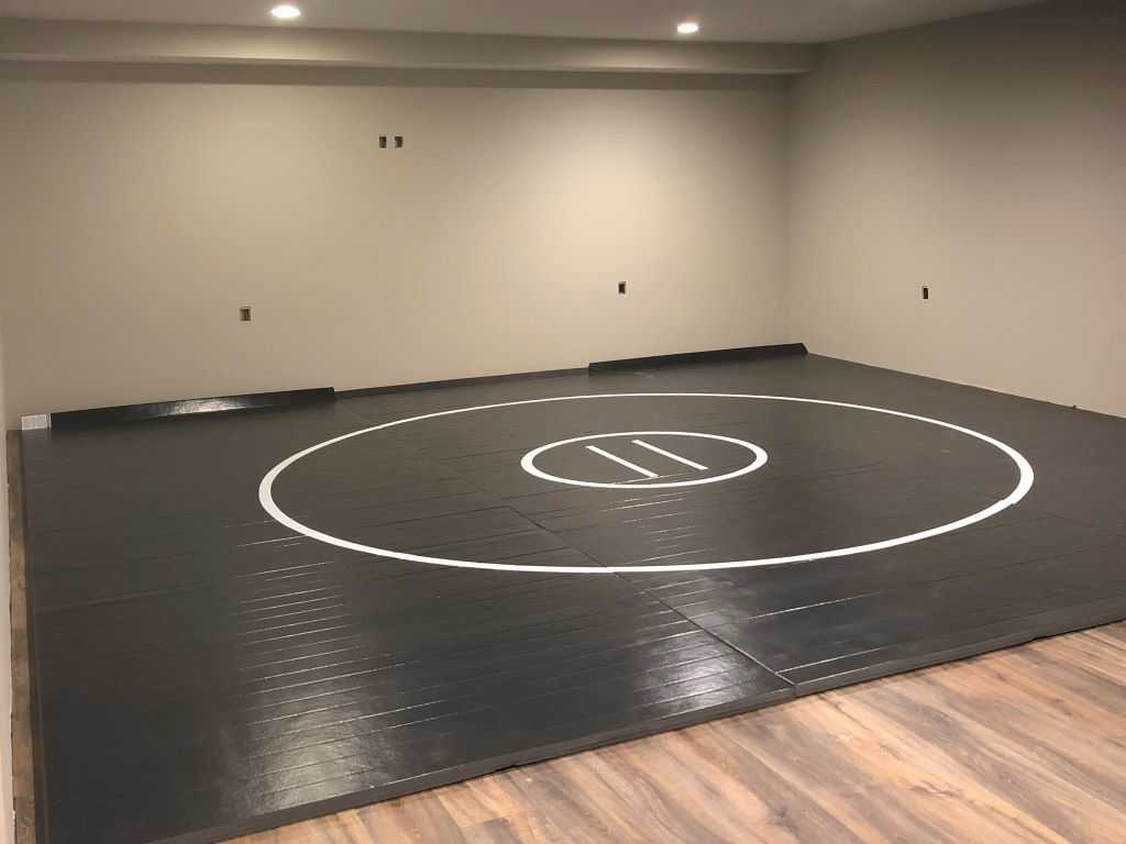 AK Athletics black wrestling mat in home wrestling room