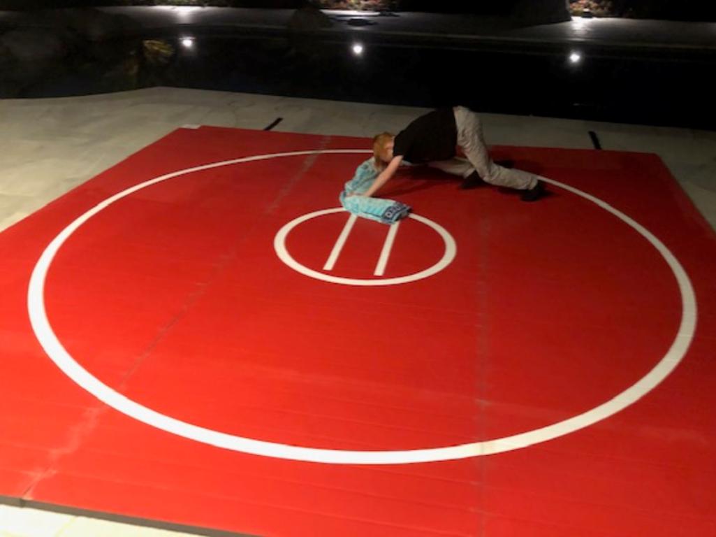 Clean a wrestling mat