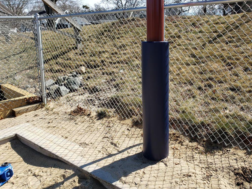 Outdoor playground pole pad