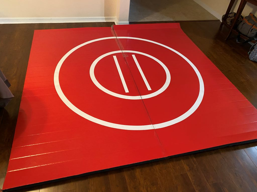 Red wrestling mat