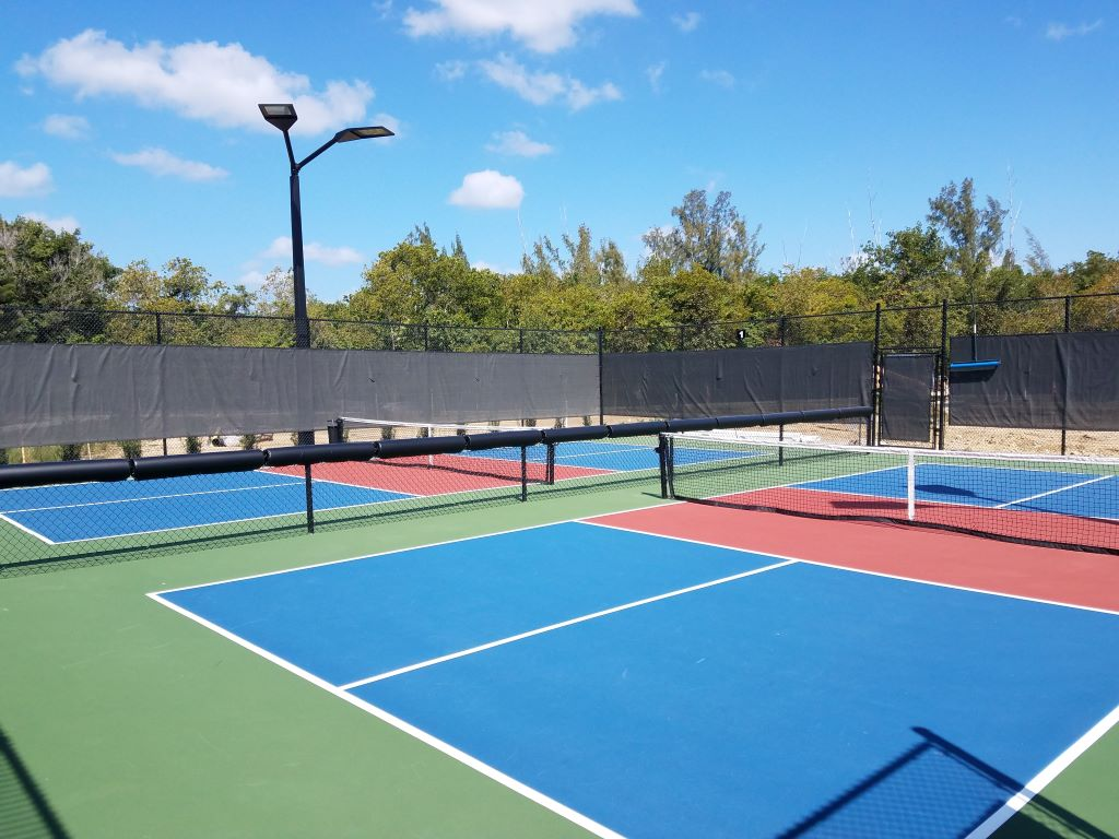 Fence pads on pickleball court