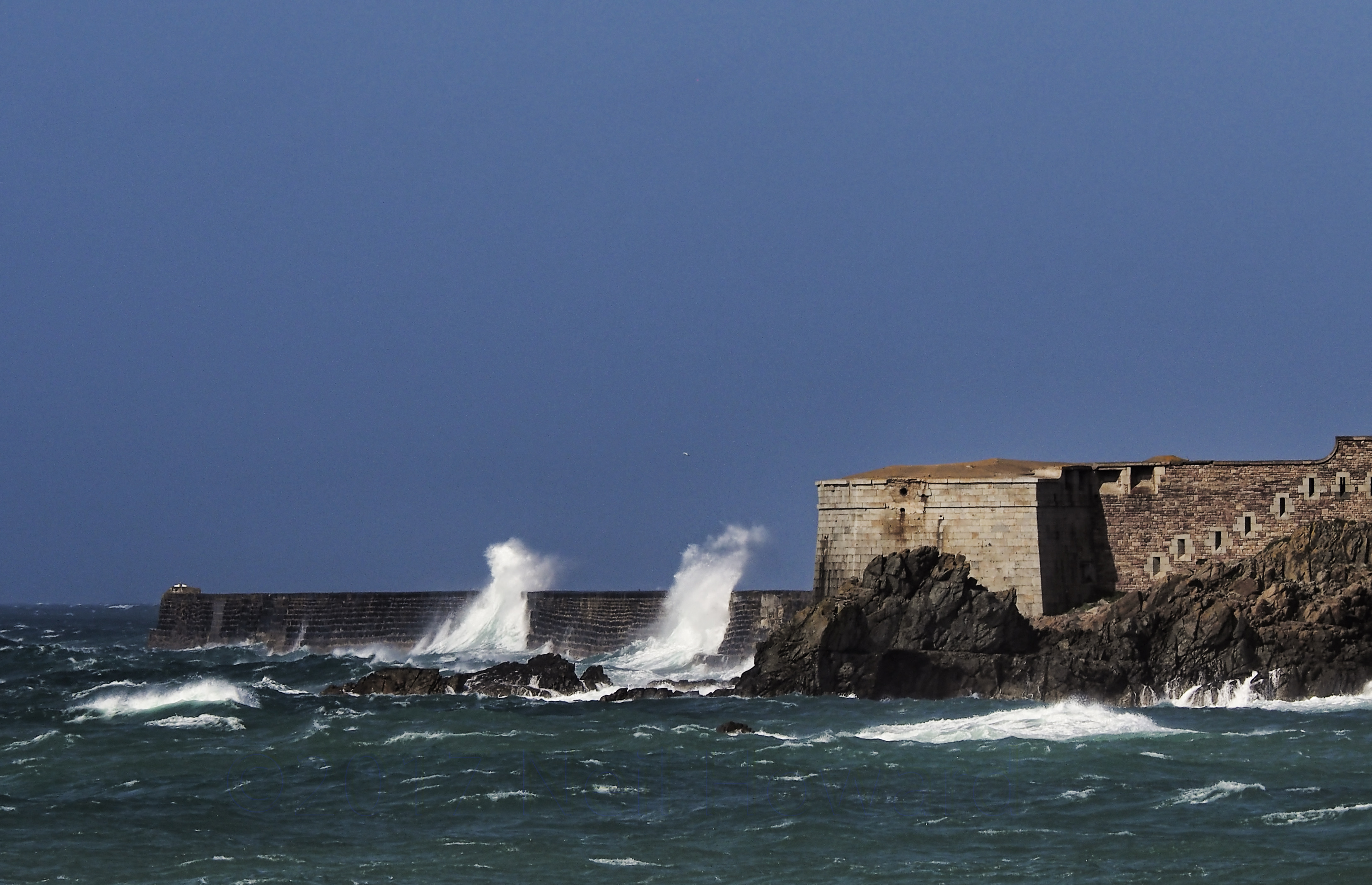 Neil howard 06.06.17 waves hitting the breakwater on alderney