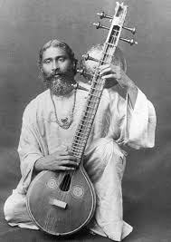 man kneeling with a zitar