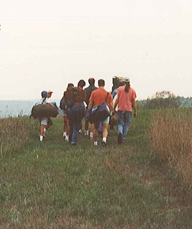 people hiking up hill