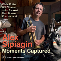 "Read ""Moments Captured"" reviewed by Andrew Luhn"