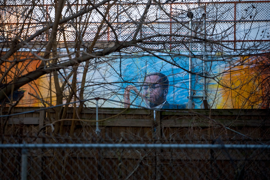 Mural in the Backyard of the Coltrane House Obscured by Fences and Shrubbery