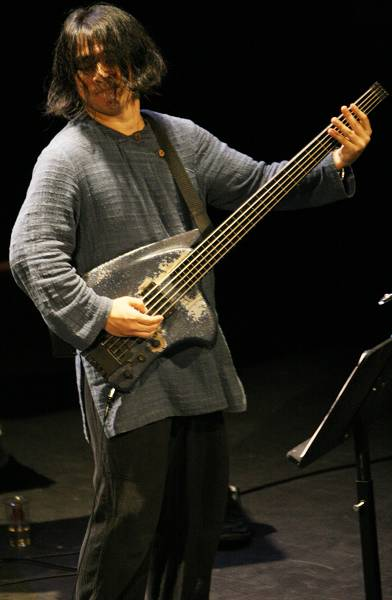 "Stomu Takeishi with ""Ahmad Mansour - Public Domain"" at the Amr Jazz Festival, Alhambra, Geneva, Switzerland, April 2006"
