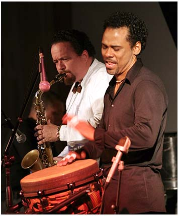 Paoli Mejias (Congas), and Ricardo Pons (Sax) at the United Community Center in Milwaukee, Wisconsin on February 29, 2008.