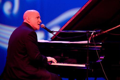 Gregg Akkerman Singing at Piano