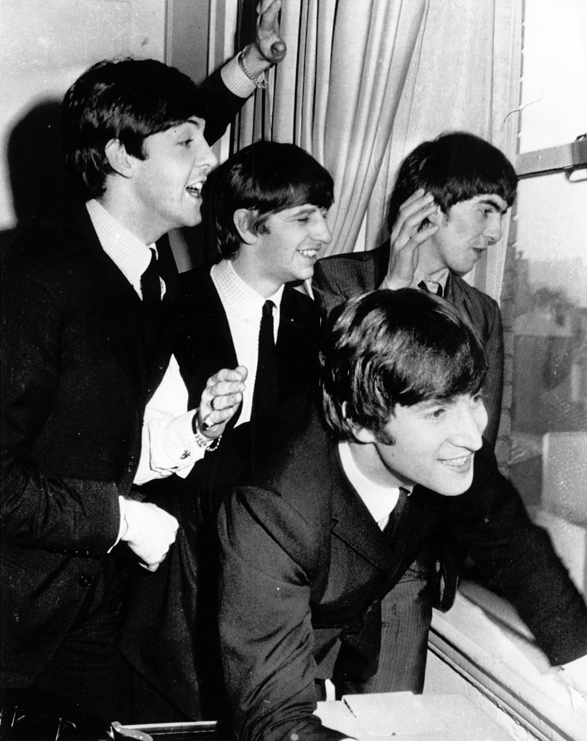 Beatles Waving to Fans