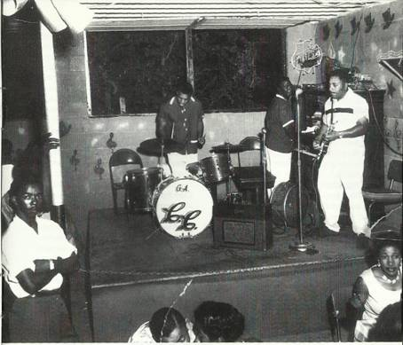 The Victory Grill (CA. 1955). WC Clark (Standing at the Left by Post) T.D. Bell on Guitar, Datney White on Piano, and George Alexander on Drums.