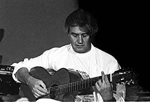John MC Laughlin Performing in 1992 with His Trio Featuring Dominique Di Piazza on Double Bass and Trilok Gurtu on Percussion.