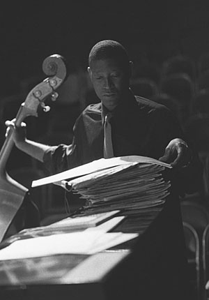 Marcus Shelby, 10/1/02 Looks Over Stacks of Compositions Prior to a Performance at Jazz at Intersection.
