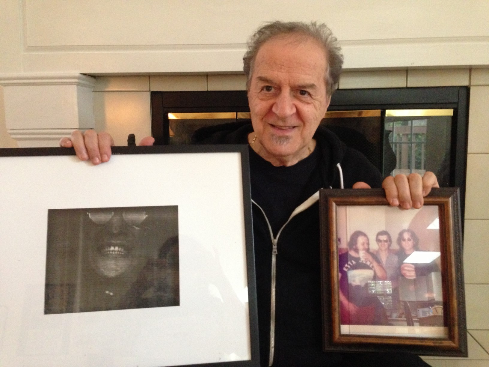Ron Aprea Holding Photos of John Lennon