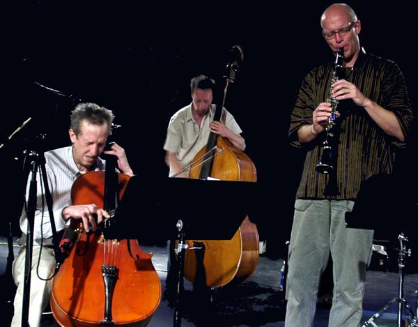 Tristan Honsinger, Ernst Glerum, and Michael Moore