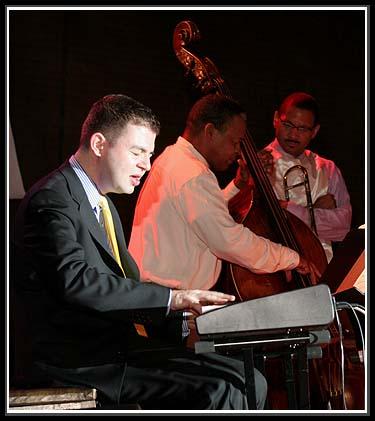 Dan Nimmer, Piano; (Background) Delbert Felix, Bass; Delfeayo Marsalis, Trombone at the 8th Summer Sizzle Jazz Festival August 5