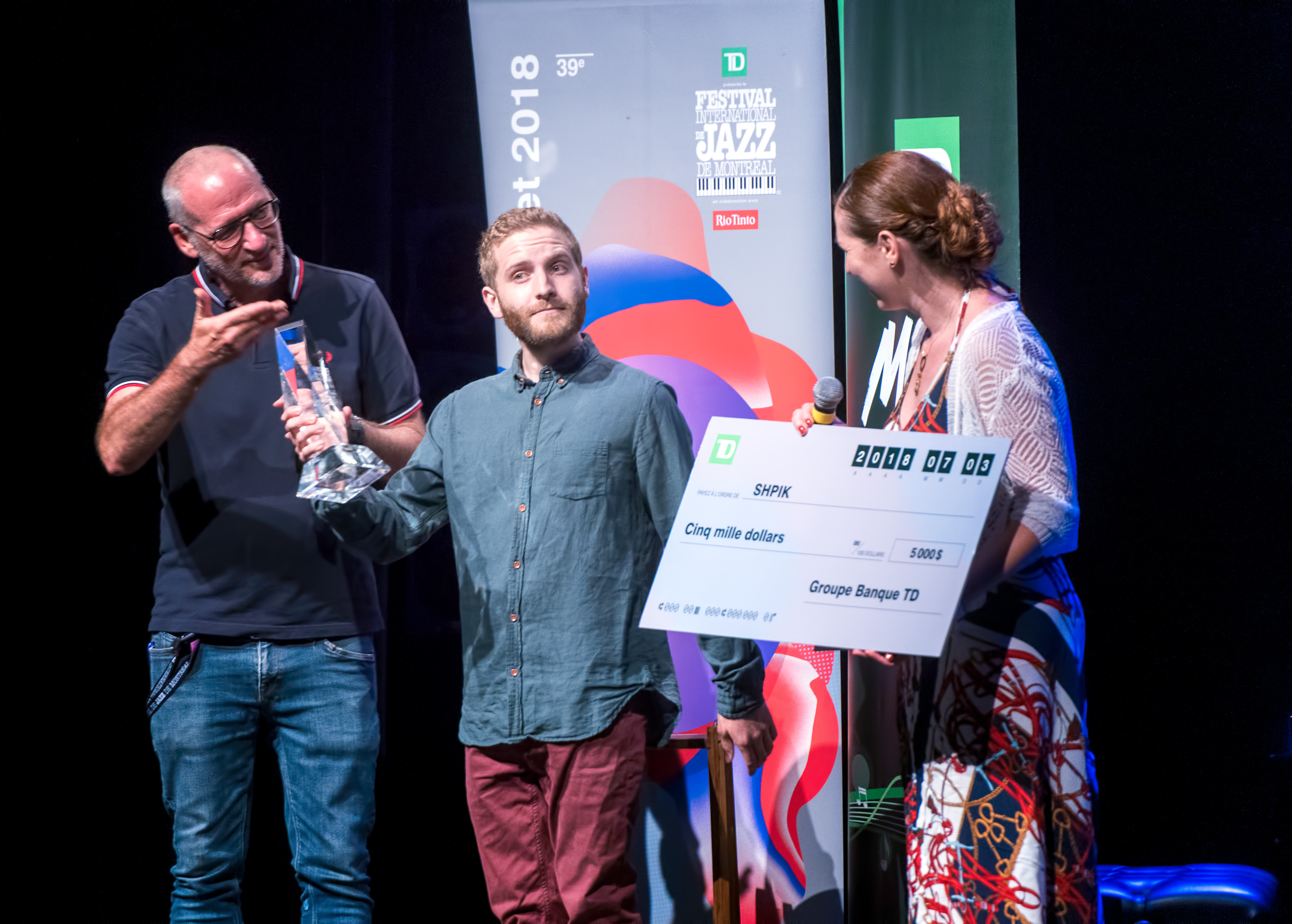 Arnaud Spick Saucier receiving the TD Jazz Competition Award on behalf of SHPIK at The Montreal International Jazz Festival 2018