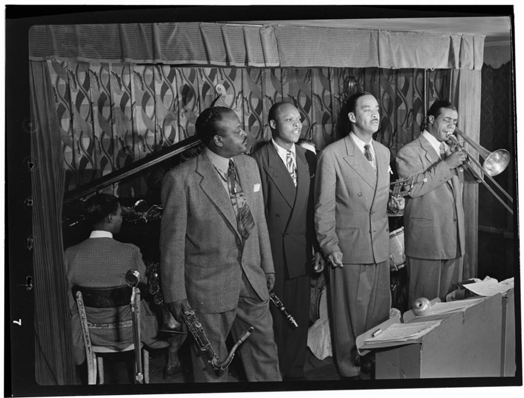 Portrait of Ben Webster, Eddie (Emmanuel) Barefield, Buck Clayton, and Benny Morton, Famous Door, New York, N.Y., CA. Oct. 1947