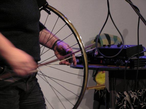 Sylvia Hallett Playing Bowed Bicycle Wheel