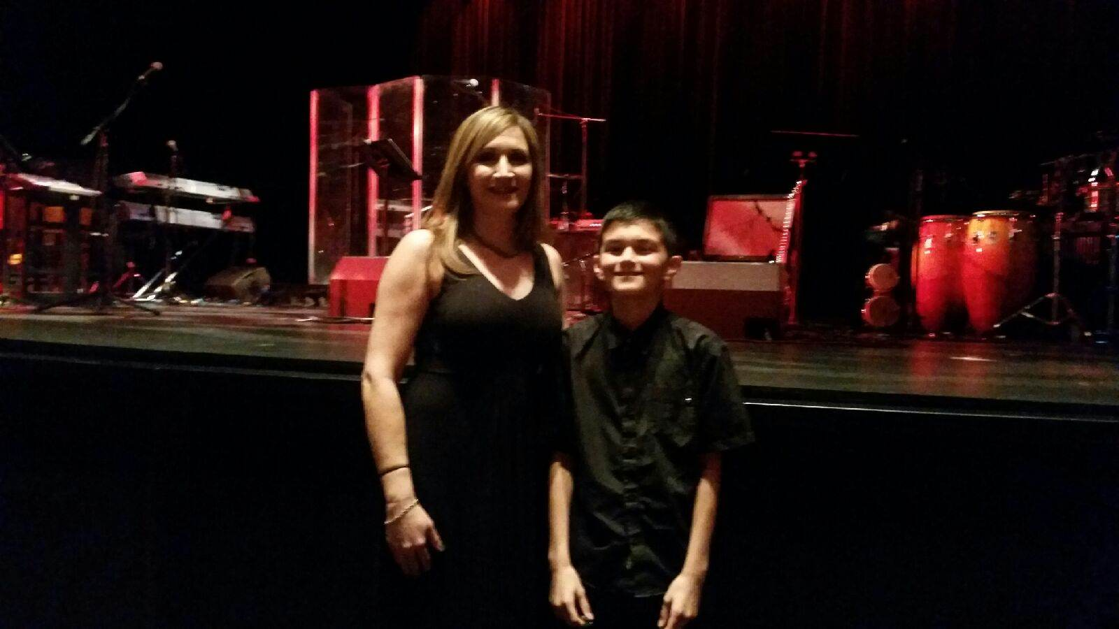 Isaac and mom before the show