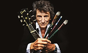 Read Ronnie Wood:  Somebody Up There Likes Me