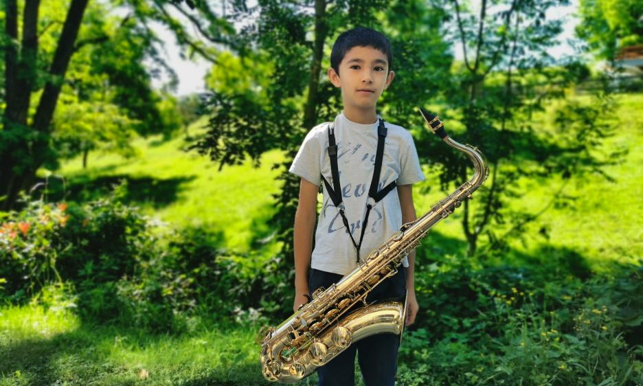 Clovis Grognuz: Young Man with Horn of Plenty