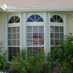 Home in South Florida with Accordion Aluminum Hurricane Shutters