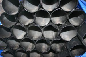Black powder coated cr30 top rail in a bundle