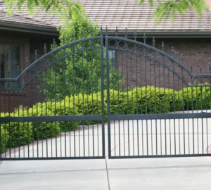 An overscallop swing gate in front of a residential driveway