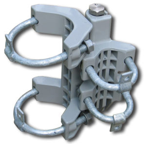 A universal self-closing spring hinge with 2 large u-bolts and 2 small u-bolts