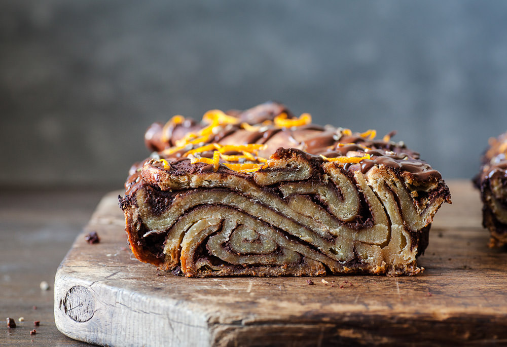 A cross section of orange cardamom chocolate babka featuring american heritage chocolate