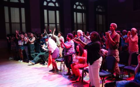 Audience members applauding at Hibernian Hall on August 16, 2018.