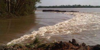 Water breaching levee