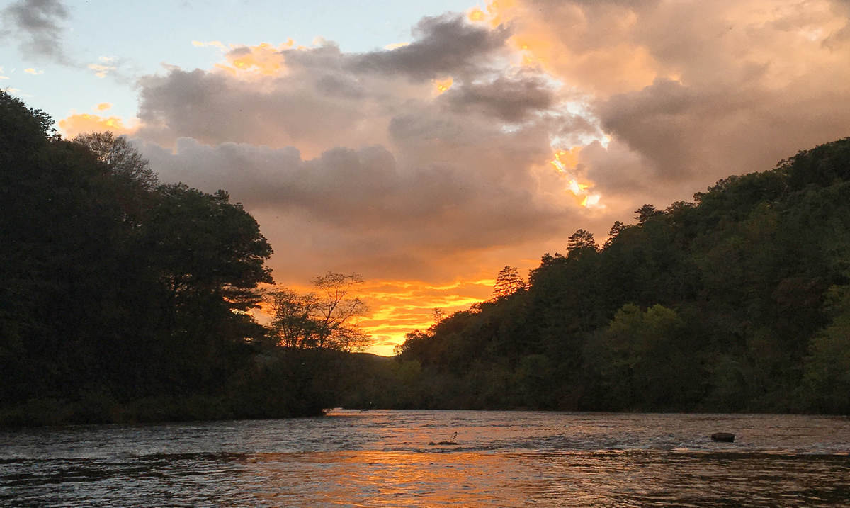 Tuckasegee River, a tributary of the Little Tennessee River, at sunset | JCTDA