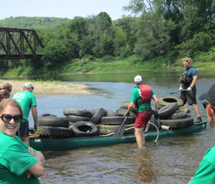 Canoe-maran at the Winooski River Keurig cleanup. | Lowell Geroge