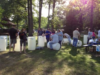 "A ""make and take"" rain barrel workshop in Toledo, Ohio with the Toledo – Lucas County Rain Garden Initiative. 