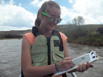 A young RRAFT participant maps the Gunnison on her rafting trip. | Dan Omasta